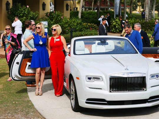 Cheryl Andrews, left center, and Shelly Stayer were among those attending the Naples Winter Wine Festival's live auction Saturday at the Ritz-Carlton Golf Resort in Naples.