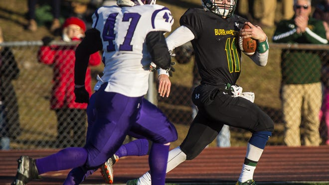 Burr and Burton's Griff Stalcup breaks lose for a touchdown run against Bellows Falls during the Division II high school football state championship in Rutland in November.