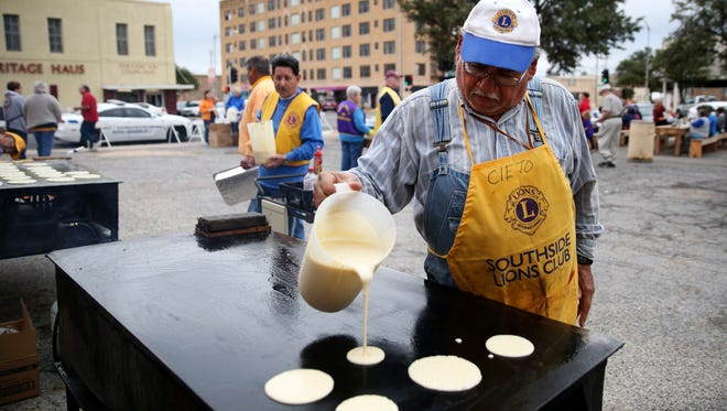 Cleto Reyes starts a fresh batch of pancakes at a Lions Clubs Pancake Extravaganza.
