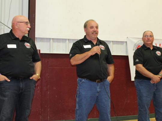 Daryl Sternweis (center), Ken Heiman (left) and Kelvin Heiman welcome members of the media to the Farm Technology Days preview in Wood County on June 5. The Sternweis and Heiman families are teaming up as host families for the annual outdoor farm show.
