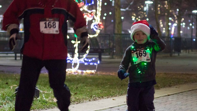 The 2014 Tinsel Toes 5K run downtown Battle Creek on Saturday.
