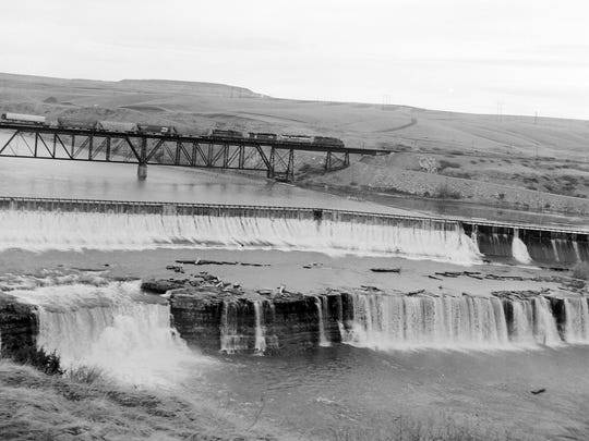 A 1971 photo shows the Rainbow Bridge and Dam, with