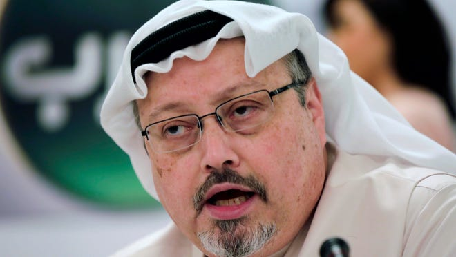 In this Dec. 15, 2014, file photo, Saudi journalist Jamal Khashoggi speaks during a press conference in Manama, Bahrain. Khashoggi and other fallen journalists were honored by Time magazine as 2018 Person of the Year.
