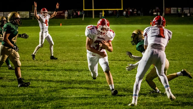 Susquehannock's Daniel Clapp (31) finds a clear path to the end zone as quarterback Kenny Rhyne (4) raises his arms in celebration against York Catholic in a YAIAA football game on Friday, Sept. 8, 2017.