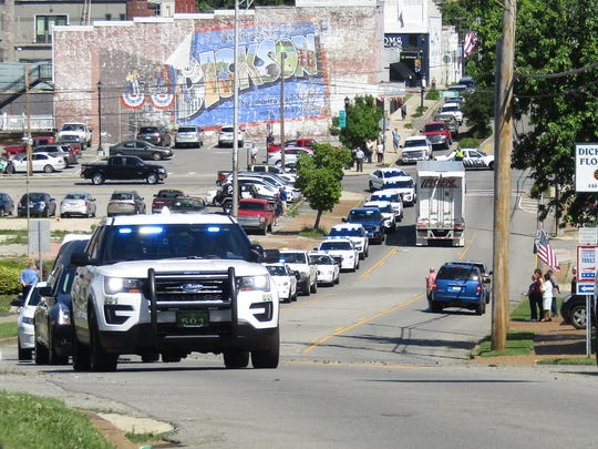 A motorcade transports the body of slain Dickson County Sheriff's Deputy Sgt. Daniel Baker to First Baptist Church Dickson, where the family will hold visitation from 2-8 p.m.