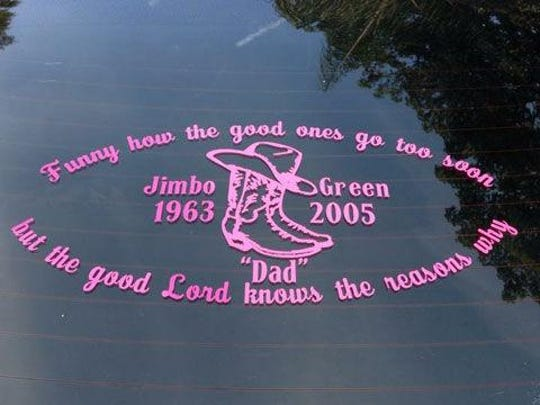 The back window of Green's car, with a memorial to her father, Jimbo Green,who died in 2005.