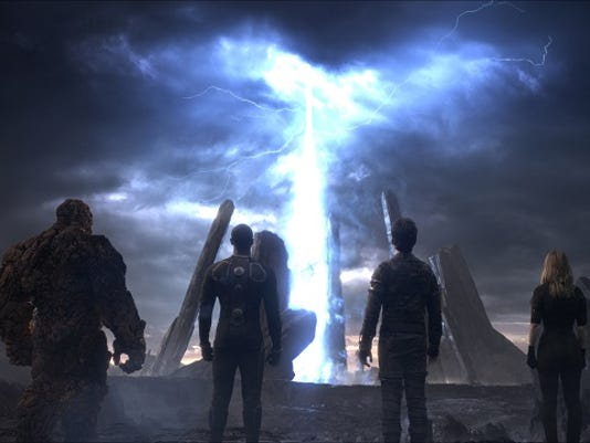 """This photo provided by courtesy Twentieth Century Fox shows, The Thing, from left, Michael B. Jordan as Johnny Storm, Miles Teller as Dr. Reed Richards, and Kate Mara as Sue Storm, in a scene from the film, """"Fantastic Four,"""" releasing in U.S. theaters on Aug. 7, 2015. (Twentieth Century Fox via AP)"""