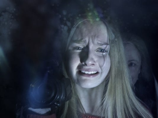 """In this image released by Universal Pictures, Olivia DeJonge, foreground, and Deanna Dunagan appear in a scene from """"The Visit."""" (Universal Pictures via AP)"""