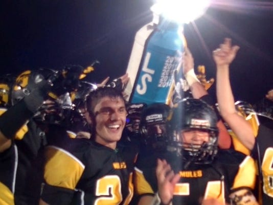 The Golden Mules hoisted the Milk Jug Trophy for the first time in school history after defeating Lampeter-Strasburg, 42-14 on Friday, September 26, 2015.