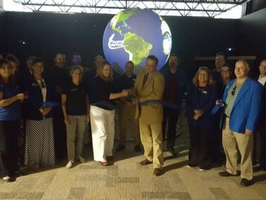 James Testwuide and Leslie Kohler recently cut a ribbon for Spaceport Sheboygan's new Science on the Sphere exhibit with Rep. Terry Katsma, Ellen Brody of NOAA and Chamber ambassadors.