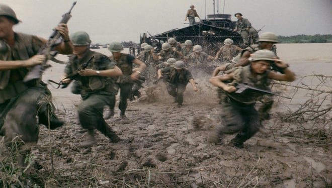 In the Mekong Delta region of South Vietnam,  9th Infantry Division soldiers disembark from an armored troop carrier in September 1967.