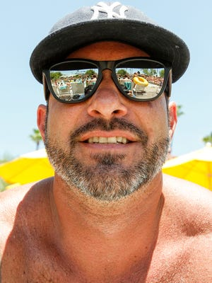 Jason Hamel from Chandler relaxes at Oasis Water Park on June 19, 2016