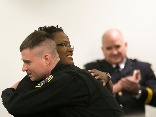 Officer Sean Haggarty, hugs, City of York Mayor C.