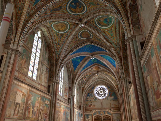 The upper part of the Basilica of St. Francis depicts
