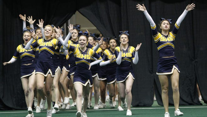 Spencerport cheerleaders take the floor during the 2014 championships.