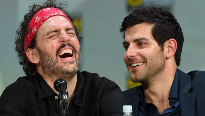 "Actors Silas Weir Mitchell (L) and David Giuntoli attend the ""Grimm"" season four panel during Comic-Con International 2014 at the San Diego Convention Center."