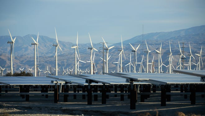 Giant turbines are powered by strong winds in front of solar panels in Palm Springs, Calif. According to reports, California continues to lead the nation in green technology and has the lowest greenhouse gas emissions per capita, even with a growing economy and population.