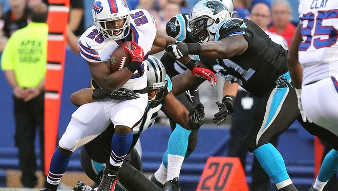 Bills running back LeSean McCoy  is tackled from behind.