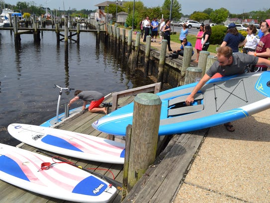 Brian Meyer, owner of Capital SUP, unloads paddleboards