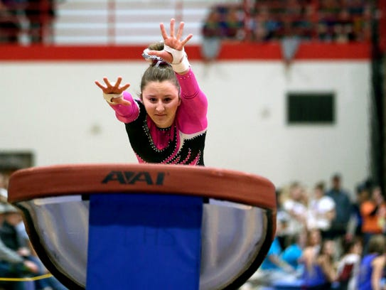 Manitowoc Lincoln's Brynn Tackett competes in the vault at the WIAA state gymnastics meet.