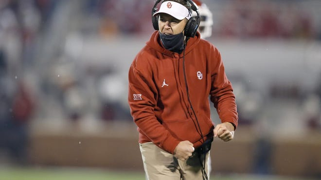 Oklahoma coach Lincoln Riley celebrates during Saturday's Bedlam win over Oklahoma State. On Monday, he said he thinks the Big 12 champion still has a playoff shot.