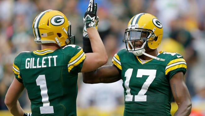 Green Bay Packers wide receiver Alex Gillett (1) congratulates Davante Adams after he scored a touchdown in the first quarter against the Kansas City Chiefs.