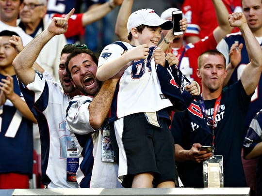 Patriots fans celebrate a touchdown during the second
