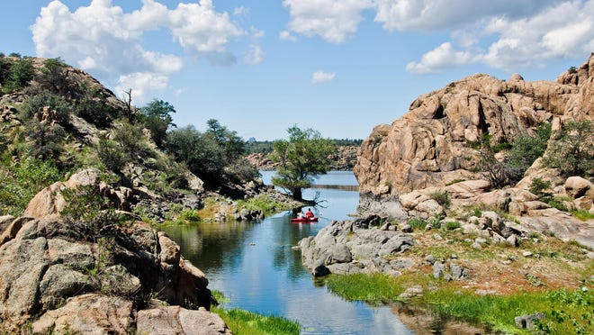 The Secret Cove Trail is a short detour leading to a secluded inlet on Watson Lake.