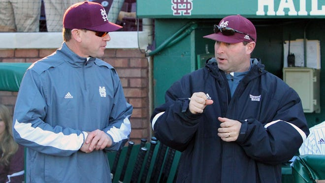Mississippi State head coach John Cohen and pitching coach Butch Thompson talking at Dudy Noble Field in 2015.