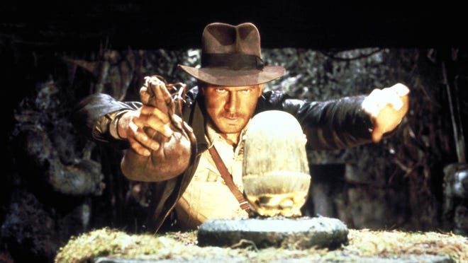 """Harrison Ford as Indiana Jones tries to grab a relic in """"Raiders of the Lost Ark."""" Harrison Ford as Indiana Jones tries to grab a relic in """"Raiders of the Lost Ark."""""""