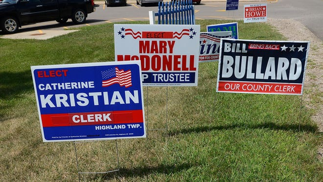 Some of the political signs on display outside the Apollo Center in Highland Township.