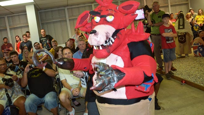 Fans compete in the costume contest during last year's Pensacola Comic Convention. The event returns to the Pensacola Interstate Fairgrounds this weekend.