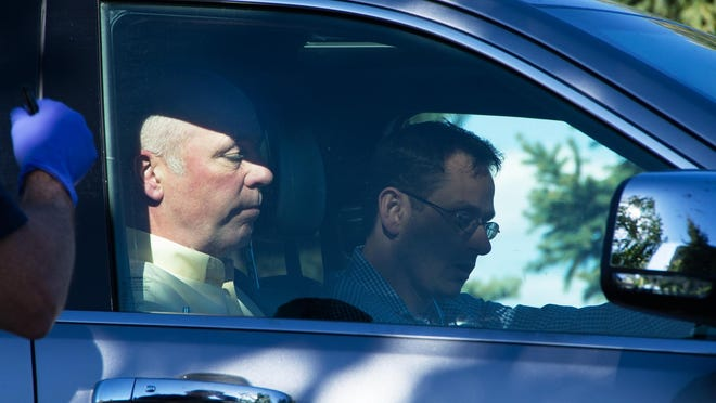 """The Republican candidate for Montana's only U.S. House seat, Greg Gianforte, sits in a vehicle near a Discovery Drive building Wednesday in Bozeman. A reporter said Gianforte """"body-slammed"""" him Wednesday, the day before the special election."""