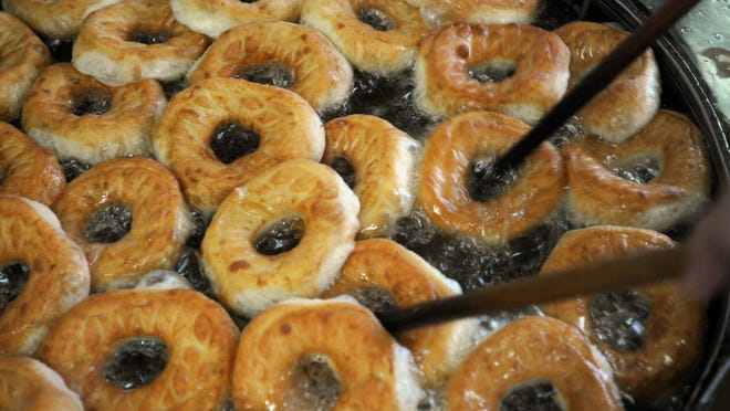 Doughnuts being made at Britt's Donuts in Carolina Beach, N.C. The shop is scheduled to reopen April 2, 2021. [STARNEWS FILE PHOTO]