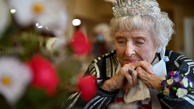 Rita Doucette strikes a contemplative pose during a luncheon in celebration of her 100th birthday at Fairview Estates in Hopkinton on Friday. For more photos, visit metrowestdailynews.com/photos.