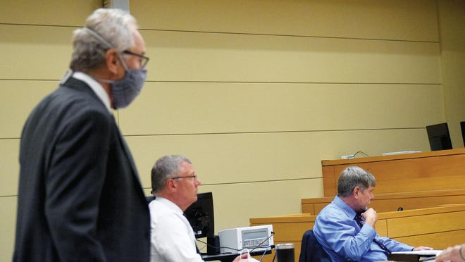 Kansas Supreme Court Justice Eric Rosen, left, prepares to resume a meeting of the 1st Judicial District Nominating Commission following a short break Tuesday at the Justice Center. Also pictured are members of the commission Ron Bates and Kevin Reardon.