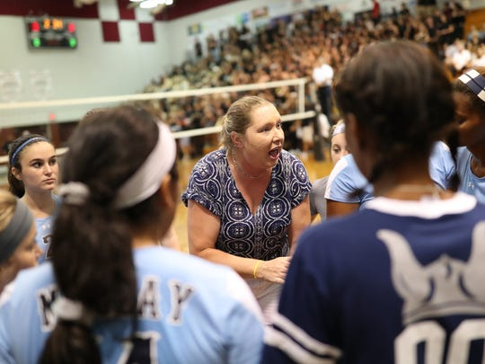 Maclay Head Coach Erica Bunch talks to her team during