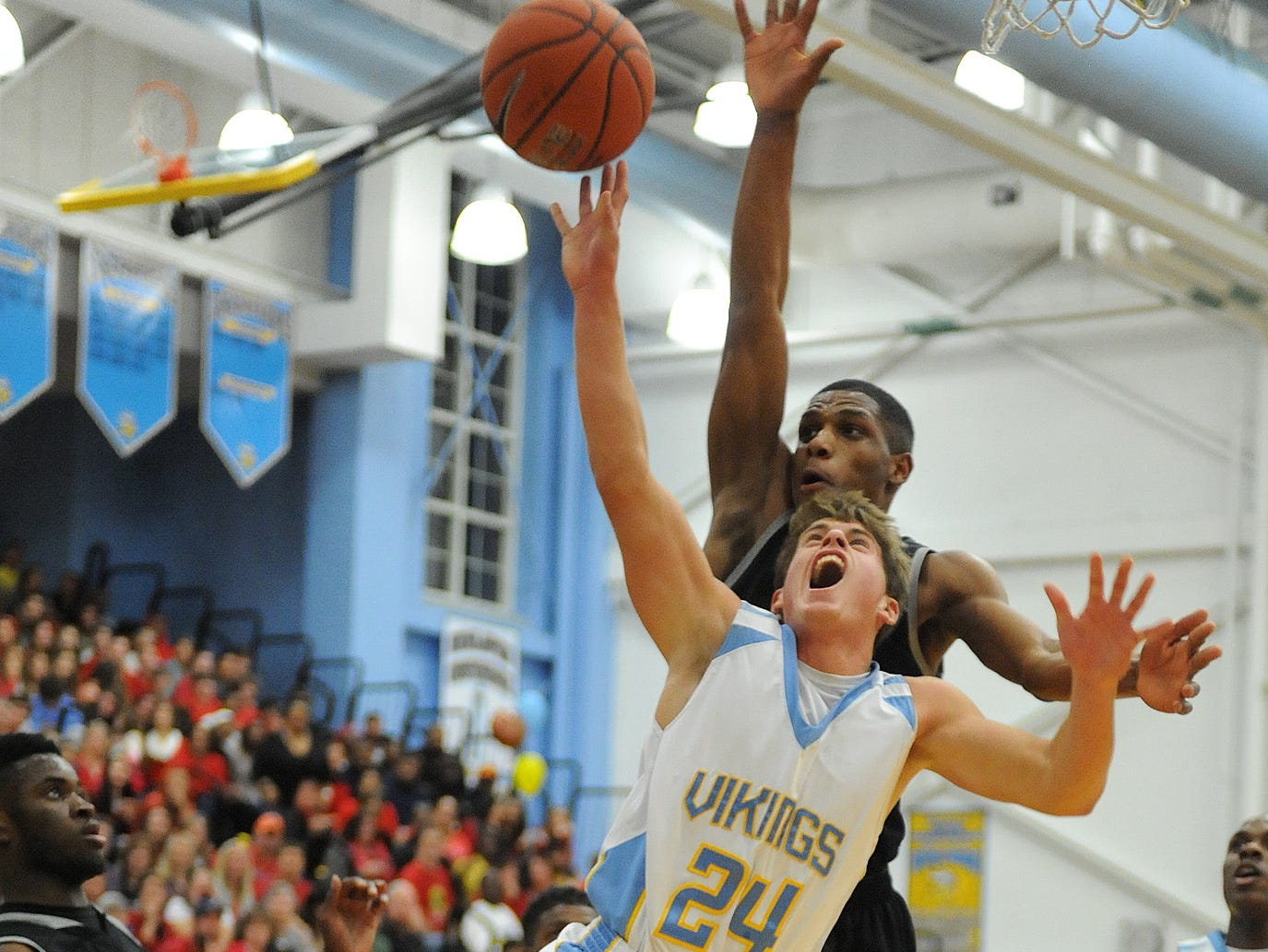 Capes Kai Vitella drives for the basket as Techs Shi'Wuan Sykes attempts block as Cape Henlopen HS hosted Sussex Tech HS in boys varsity basketball at the school near Lewes on Friday Feb. 14th. Special to the Daily Times / CHUCK SNYDER