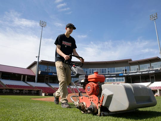 Drew Eastman mows the infield grass in advance of the