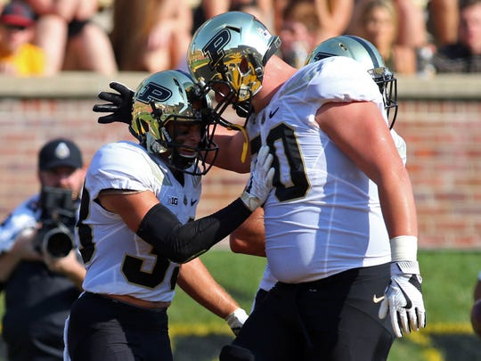 Sep 16, 2017; Columbia, MO, USA; Purdue Boilermakers wide receiver Jackson Anthrop (33)is congratulated by Purdue Boilermakers offensive lineman Dave Steinmetz (70) after scoring a touchdown against the Missouri Tigers in the first half at Faurot Field. Mandatory Credit: Jay Biggerstaff-USA TODAY Sports