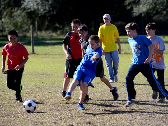 Beulah Academy of Science students play soccer during gym class.