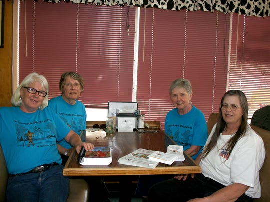 From left, Nancy Hamby, Julia Westerberg, Bonnie O'Connell and Dar Parrow talked up an upcoming convention for walkers in Salem at Holding Court on Tuesday.