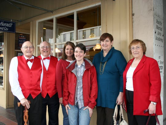 Members of the Just For Fun Singers and leaders from the Inter Faith Hospitality Network congregate outside of the Court Street Dairy Lunch during Holding Court on Tuesday. From left are: Richard Hohnbaum, Jerry Rempel, Julie Brown, Jill Summers, Pat Leddig, and Judy Dyer.