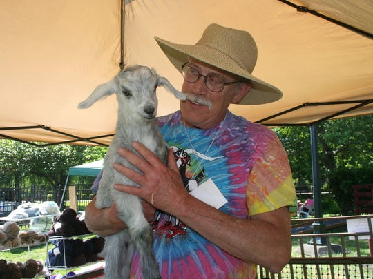 Paul Johnson raises cashmere goats and sells cashmere fiber and yarn. He and his wife, Linda Fox, appeared at Saturday's Sheep to Shawl Family Fun Festival at the Willamette Heritage Center at Mission Mill.