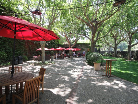 The garden at Louis M. Martini Winery invites summer sipping and picnic lunches. The winery was among the first to open in the Napa Valley after Prohibition. Third-generation vintner Mike Martini leads the wine making.