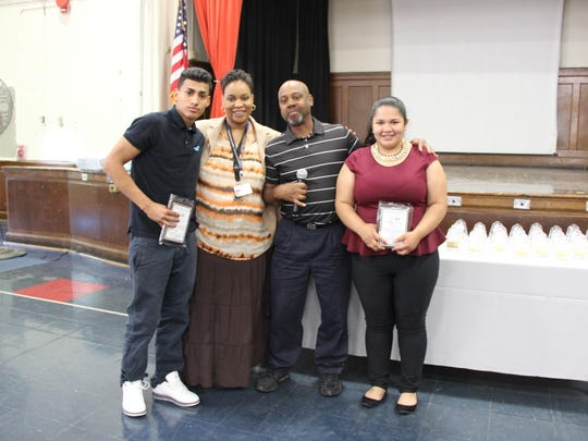 Plainfield Public Schools' Barack Obama Academy for Academic and Civic Development conducted its awards luncheon last month. Graduating seniors Milton Vladimir Guardado, left, and Martha Palacios, right, were recognized for their meritorious development and academic excellence. They are pictured with Vice Principal Deitria Smith-Sneard, and business/technology teacher Gregory Powell. The Barack Obama Academy of Academic and Civic Development (BOAACD) is a public alternative high school, consisting of grades nine through twelve, that promotes academic academic achievement and civic responsibility.