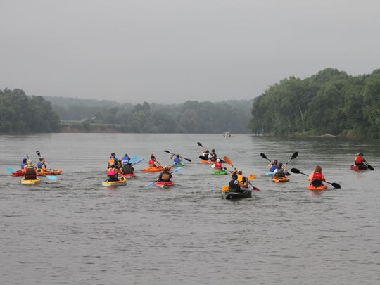 A canoe and kayak race on the Cumberland River in Tennessee.