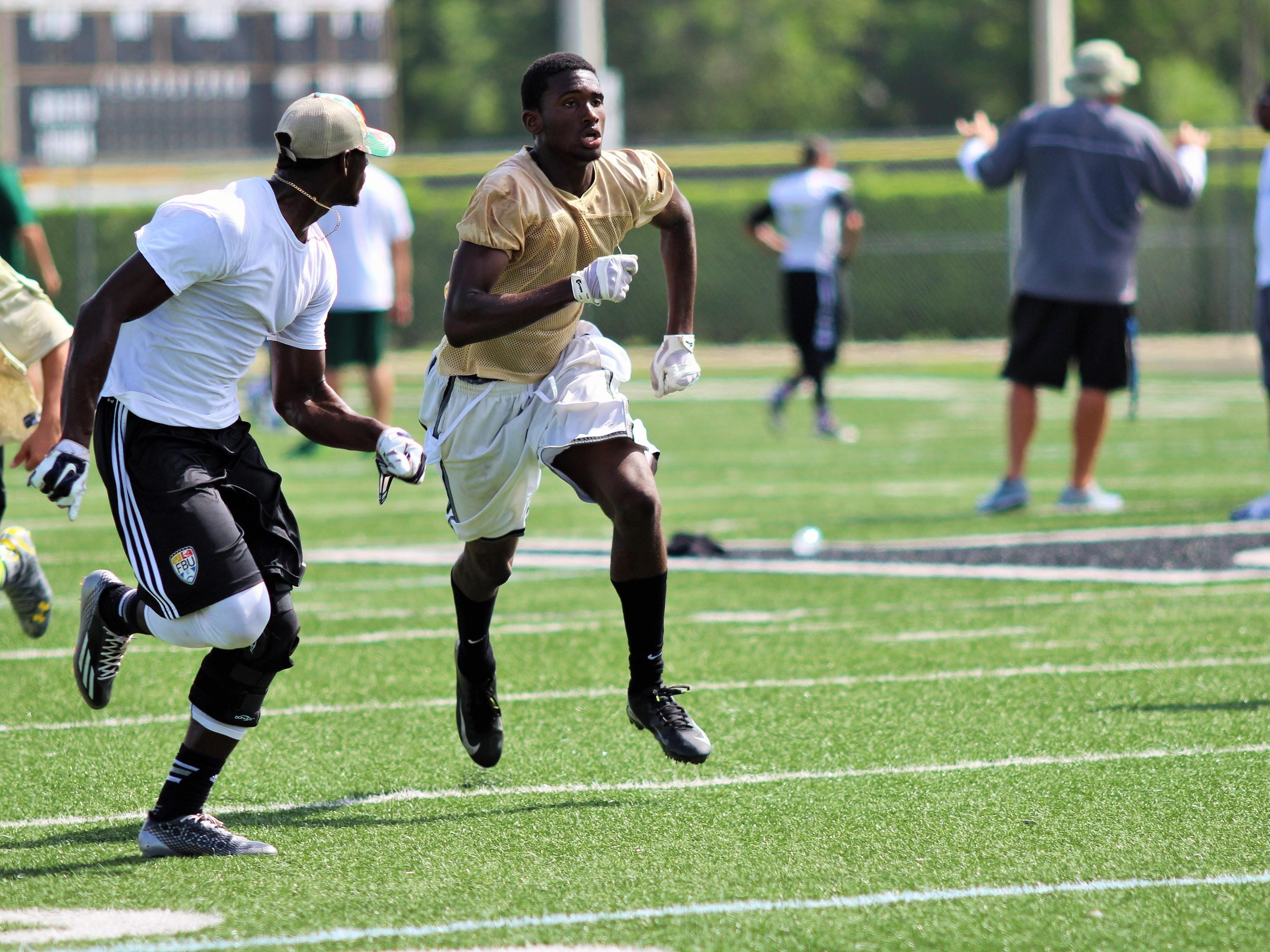 Golden Gate wide receiver Patrick Volcy runs a play during a 7-on-7 game at Golden Gate High School on July 8, 2015.