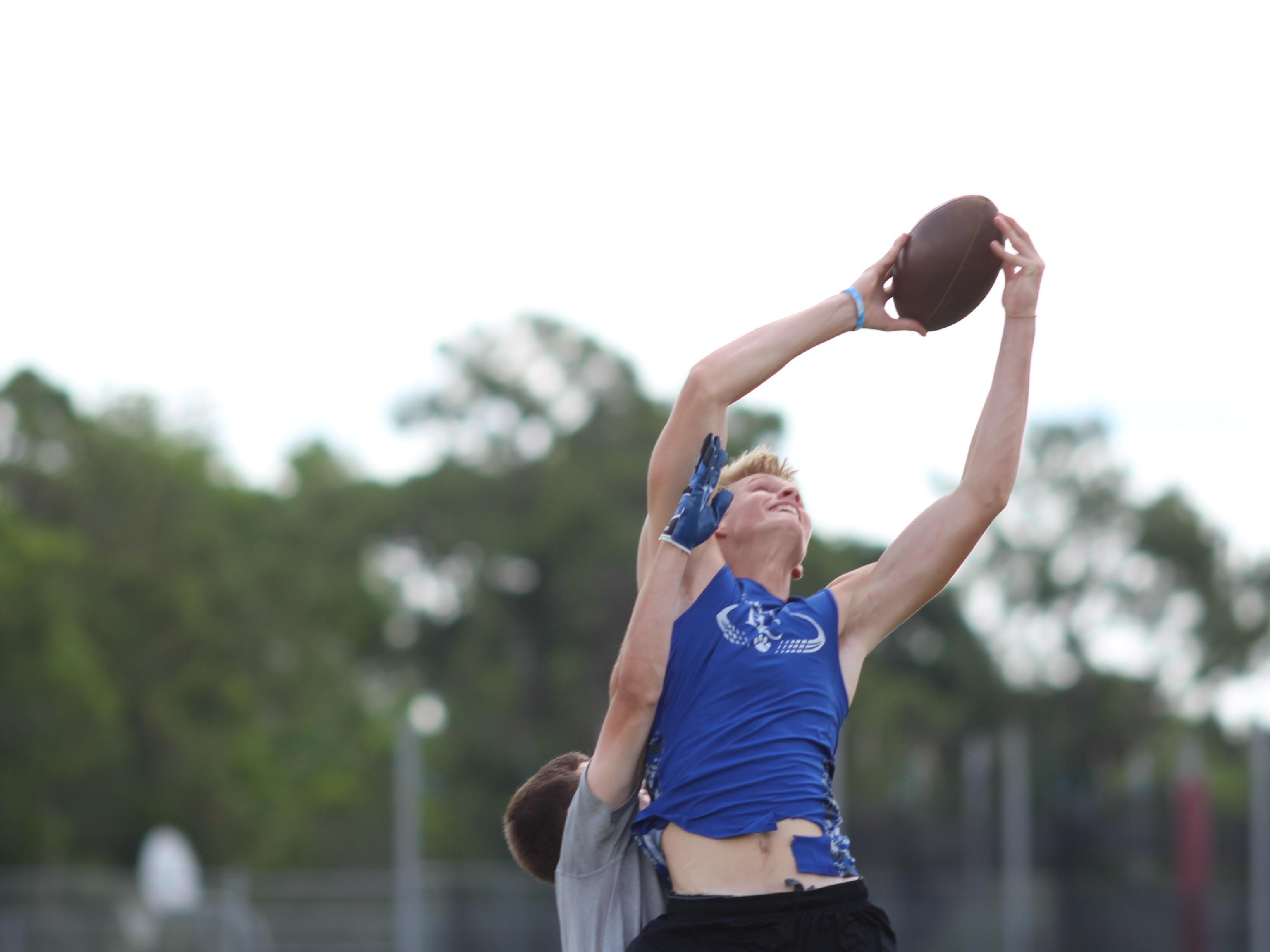 Barron Collier's Matt Heuerman stretches to catch a ball during a 7-on-7 game at Golden Gate High School.