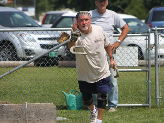 Brian Simmons lets a show fly during at tournament at the Sodbusters Horseshoe Club in Bristol, Vt. Simmons is a three-time world champion in horseshoes.
